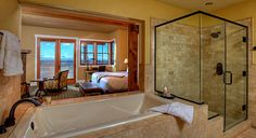 Luxurious bathrooms include soaking tubs and separate showers