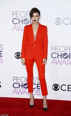You can't miss her! Ruby Rose rocked the People's Choice Awards red carpet in a bright ora...