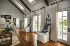 Multiple sets of French doors line the HGTV Dream Home 2015 great room, showing off the stunning view outside and allowing more natural light to brighten up the space. Home Living Room, Living Spaces, Living Area, Barn Living, Wooden Beams Ceiling, Hgtv Dream Homes, French Country Living Room, Bedroom Pictures, Decoration
