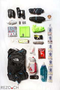 Chamonix, France - 08/29/2013: Content of Timothy Olson's backpack for UTMB 2013. Most of the material is mandatory (like two pairs of headlamps, a drinking cup or a survival blanket), but every runner has some degree of freedom to customize his kit. Tim's bag is said to weight approx 4.4 pounds (2kg). Credit: Niels Ackermann for the New York Times