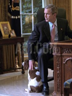 President George W. Bush Pets Spot in the Oval Office of the White House. Oct. 1, 2001 Photo at Art.com