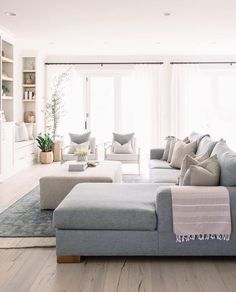 Beautiful light gray couch, bright windows