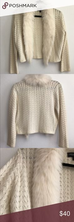 Carmen Marc Valvo Cream Fur-Trim Sweater From designer Carmen Marc Valvo, this rare sweater is stunning and cozy, with a unique fur detailing wrapping around the collar and down the front of the sweater. In perfect condition.                                                                    Please note: This sweater is marked as a size large, but it fits like a size small. Carmen Marc Valvo Sweaters