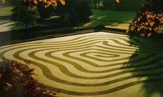 """The most ephemeral of all labyrinths.    """"Chris Parsons, who refers to himself as a 'groundsman', is a master of dew painting, vanishing by lunchtime."""""""