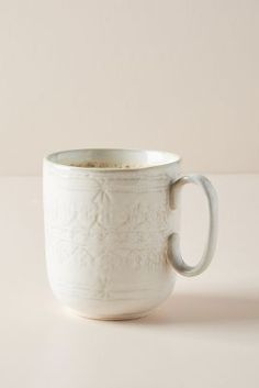 Zizou Mugs, Set of 4 by Anthropologie in White, Mugs Versatile enough for both casual and elevated dining, this classic dinnerware is updated with a subtly etched motif. Glass Coffee Mugs, Unique Coffee Mugs, Stoneware Dinnerware, Dinnerware Sets, Mother Day Gifts, Gifts For Mom, Egg Mug, Classic Dinnerware, Latte Cups