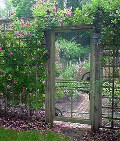 Cool idea ~ used an old screen door for a garden gate! This would work well with tall fences like deer fences.