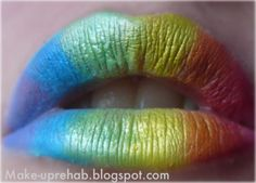 Keep your eyes simple and make your lips the focus with rainbow lipstick.
