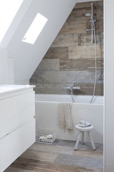 Sloped Ceiling Bathroom - Feature wall at back of shower Also - Simply mounting fittings to the back wall might allow more space to the taller area