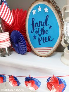 All American DIY mantel decor. This 4th of July wood slice was made with some @Tattered Angels paints and @canvascorpbrand paper and fabric. Land of the Free!