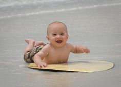 Skimboarding! Great summer beach photos for the baby who can easily lift his head, or starting to crawl but can't walk yet. Plus it blocks the sand that he want's to eat! lol