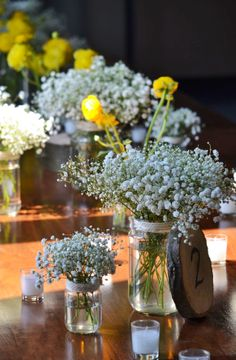 Bright yellow spring time ranunculus blooms in bud vases and bunches of baby's breath in jars made for lovely tablescape flowers for R&S wedding. They were a lovely compliment to the rustic and lofty feel of the venue: The Green Building, in Brooklyn NY.   Flowers and photos by your truly, Rosehip!