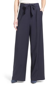 Swooning over these wide-leg trousers that pair perfectly with a white blouse for a chic office look.