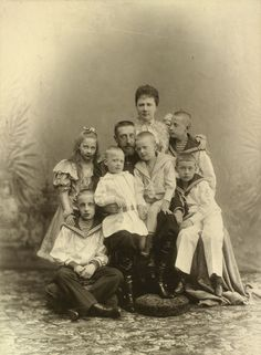 Photograph of Grand Duke Constantine Constantinovich (1858-1915) with his wife Grand Duchess Elisabeth Mavrikievna (1865-1927) and six eldest children. Grand Duke Constantine is sitting at the centre of the group with Prince Igor Constantinovich
