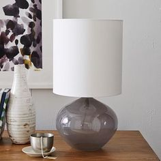 """Nook Glass Vessel Table Lamp $99 10""""diam. x 18.6""""h. Glass base. Linen shade in White. Polished Nickel hardware."""