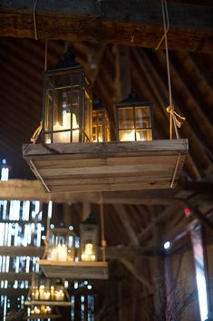 Hanging lantern platforms. Barn wedding with woodland decor by Kelly Sweet Photography | junebugweddings.com/my love