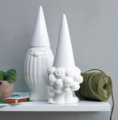 West Elm Modern Gnomes, buy 3 sets keep one white and spray paint the others gold and glossy black. Then place around inside or outside of the home
