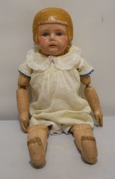 """An antique Martha Chase oilcloth doll, 16.5"""" tall, from the earliest part of the 20th century."""