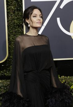 Angelina Jolie in Atelier Versace black gown at the 2018 Golden Globe Awards. #celebrity #celebritystyle #goldenglobes #awards #hollywood #awardsseason #celebrityfashion #fabfashionfix #angelinajolie #versace