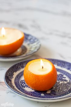 Homemade Orange Peel Candles mandarin orange candle on a blue china plate with a navel orange scented candle in the background on a marble countertop Diy Candles Scented, Homemade Candles, Mason Jar Candles, Soy Candles, Orange Peel Candle, Orange Candles, Shell Candles, China Plates, Candle Making