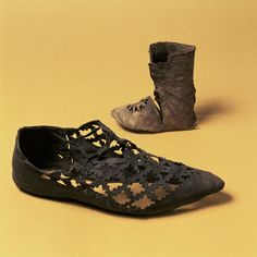 Medieval men's festsko party shoe and baby boot (1300-1500 AD) - Medieval Stockholm Museum
