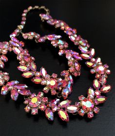 Sherman Necklace Signed Pink Aurora Borealis Flower by WholeheartedVintage on Etsy https://www.etsy.com/listing/257364225/sherman-necklace-signed-pink-aurora