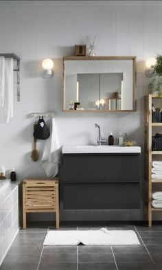 Your bathroom is one of the most important rooms in your home for getting your day started and winding down at night. Glossy GODMORGON cabinets mixed with the natural birch wood of MOLGER storage provides the organization you need with a balanced look and relaxing feel.