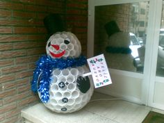 Snow man made out of plastic cups.