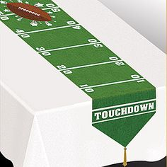 This Game Day Football Table Runner looks like a football field with a football at the center line and features a tassel at each end.