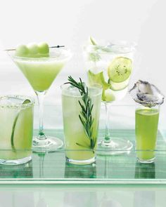 Add signature drinks that play up the palette of a green wedding. White rum, basil simple syrup, and honeydew melon liven up this Garden Daiquiri. Green Cocktails, Fancy Drinks, Cocktail Drinks, Cocktail Recipes, Cocktail Ideas, Summer Cocktails, Drink Recipes, Martini, Mojito