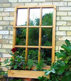 Buy this Georgian Window style outdoor garden mirror online.  The frame is finished in a clear wood treatment, but you can paint it to match your outdoor mirror to your own garden colour scheme.  Comes with windowbox planter as standard, but you can use it without as our picture demonstrates  Fix to a garden wall, shed, or fence to create a stunning illusion. Dimensions:  H 110cm W 68cm  Georgian Window Garden Mirror will instantly transform an ugly garage wall, l