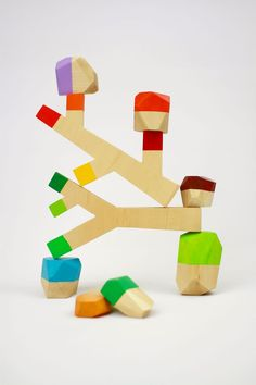 Sticks & Stones — Water & Lightning. Simple wood toy blocks with branch and rock shapes for kids.