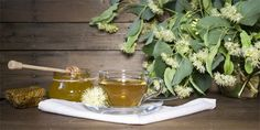 Linden tea in glass cup and jar with honey with linden flowers on a dark wooden background Wooden Background, Alcoholic Drinks, Honey, Jar, Stock Photos, Glass, Flowers, Food, Syrup