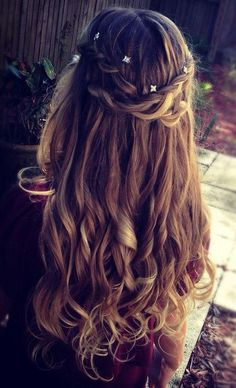 Beautiful prom hair with some braided pieces pinned back.