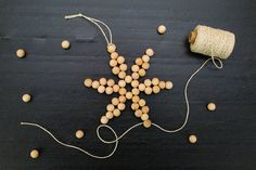Use the detailed instructions at Tinsel + Trim to craft delightful snowflake ornaments out of wooden beads and twine. Make them in a variety of sizes—using differently sized beads—for a full display on the tree or the wall.