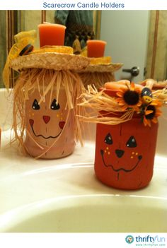 Recycle jars into scarecrow candle holders.o