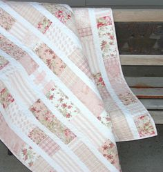 This is a quilt I made a couple of years ago and a few other quilts using this simple design. I'm contemplating using this same pattern design for the girls' rooms with brighter fabrics.