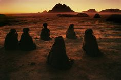 """Kuchi Nomads, Evening Prayer, Kandahar, Afghanistan, 1992"" by Steve McCurry"