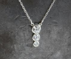 Soooo elegant! Can be made also with genuine diamonds. Available in silver and solid gold with zirconia, real diamond or other gemstones. This necklace