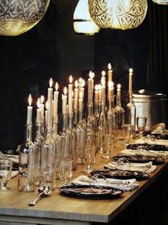 Candles in empty wine bottles. Beautiful and eery center piece for dining room table.