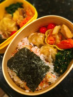 Nori Ben  Rice with sprinkles and Seaweed(nori), dumplings, spinach with sesame, agave and soy sauce, chicken and potato stew, and cherry tomatoes.