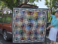 Love the applique on this quilt