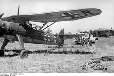 German mechanics working on a Henschel Hs 126 reconnaissance aircraft. South Italy, 1943.