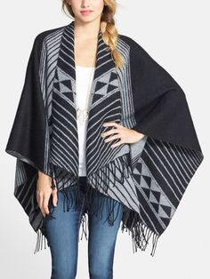 This poncho is so adorable! Love the fringe.