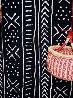 African black and white textile and woven red and white basket