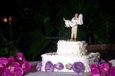 Wedding cake at Dreams Riviera Cancun with cute beach wedding topper.