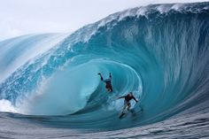 US Garrett McNamara (L) and US Mark Healey (R) compete during a free session of surf tow in, in the southern Pacific ocean island of Tahiti, French Polynesia, on June 1, 2013 in Teahupoo. AFP PHOTO GREGORY BOISSY
