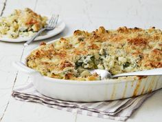Get Spinach and Artichoke Dip Mac 'n' Cheese Recipe from Food Network- this needs a tortilla chip crumble and salsa.