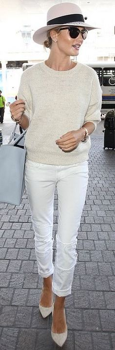 Who made Rosie Huntington-Whiteley's black hat, tan sweater, watch, blue handbag, white patch jeans, and pumps?