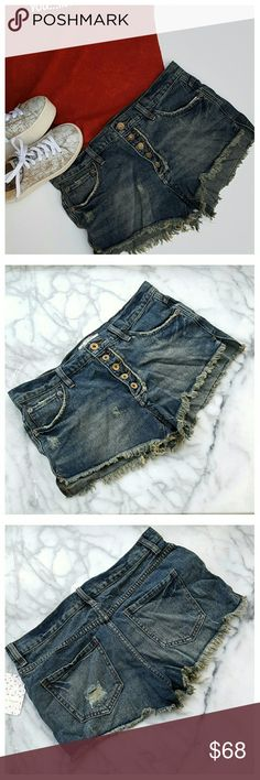 """Free People Runaway Slouch Cutoffs - Jillian Blue Distressed slouchy cutoff shorts with fringed hem and exposed button fly. Medium wash, classic five-pocket styling. Width at waist 16"""", front rise 9"""", back rise 13"""", inseam 2.75"""". 100% cotton, machine wash/dry. Free People Shorts Jean Shorts"""