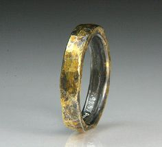 This ring is in the same family as our bracelet named Hephaestus. Named after the god of fire and the forge. He is the patron god of blacksmiths, craftsmen, artisans, and sculptors, which serves as the foundation of all metallurgy.  I hand forged this ring from sterling silver and added 23-karat gold leaf. I used the Korean technique of Keum-boo to apply the 23 karat gold to the silver. The silver has been oxidized to give a lovely burnt patina.  Current size is 9 5/8 convo us if you need a…